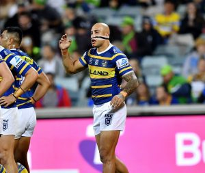 Action shot of Blake Ferguson playing for the Parramatta Eels, with his nose heavily taped after injury